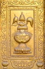 golden gilded asian temple door ornamental fragment