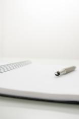 Ink pen on spiral notebook