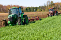 Two Tractors Plowing in Tandem