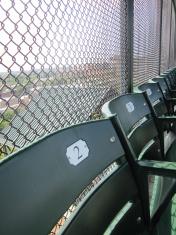 Back row of bleacher seats in ballpark