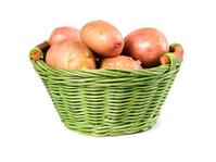 Raw potatoes in a wicker basket