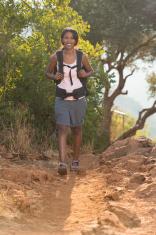 Woman backpacker on trail.