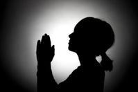 Girl prays to heaven.