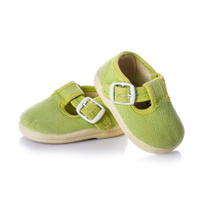 Green sneakers shoes for kids isolated on white background