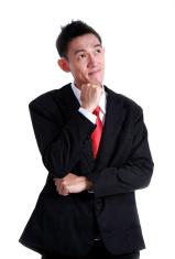 Businessman thinking on white background