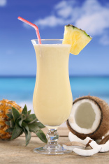 Pina Colada cocktail with fruits on the beach