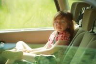 Transportation. Little girl child kid sitting in the car