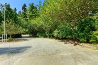 Gravel driveway. Countryside landscape