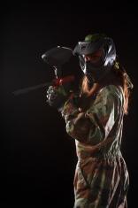 Studio shot of woman paintball player