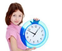 Cute Girl Shows the clock