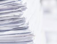 closeup stack of newspaper