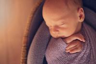 Close up of newborn baby in basket