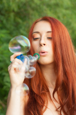 Redhead blowing bubble