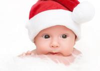 cute newborn baby in christmas hat
