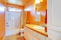 Bright orange bathroom interior