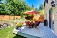 Backyard patio area with landscape