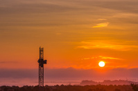 crane with rising sun