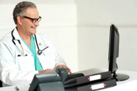 Experienced doctor working on computer