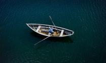 Senior Man in a Dory Row Boat.