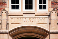 Public School Sign Carved in Granite above Entrance