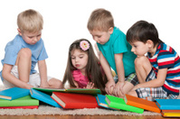 Four kids with books
