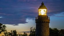 Granite lighthouse by during a Scandinavian midsummer midnight