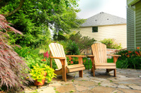 Outdoor rest area. Backyard with wooden chairs