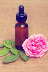 Rose essential oil in bottle,