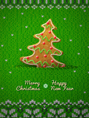 Christmas tree cookie on knitted background