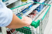 male hand pushing shopping cart at supermarket