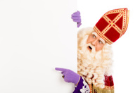 Sinterklaas pointing on placard