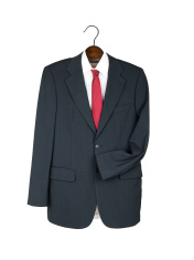 Man's business suit, shirt and tie on clothes hanger.