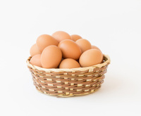 egg in basket wicker on white background