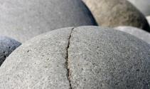 Smooth round stones on seashore