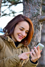 Young woman browsing smart phone.