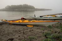 Sea kayaks on a foggy morning