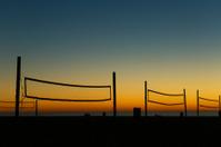 beach volleyball nets at sunset