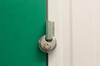Round heavy duty pad lock on self storage unit