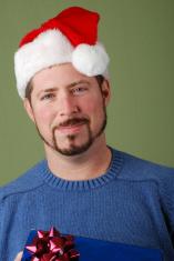 Santa Claus bearing gift