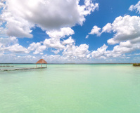 pier and palapa in Caribbean Bacalar lagoon, Quintana Roo, Mexic