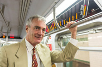 Senior Businessman in the Subway Train