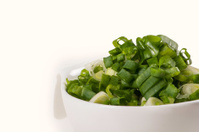 Chopped chives in cup