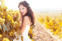 Bride in a vineyard, autumn