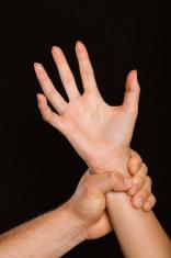 Male hand grabbing female wrist