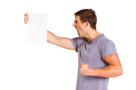 Angry man shouting at piece of paper