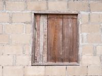 wood window on brick wall