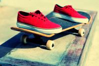 sneakers on skateboard at skatepark