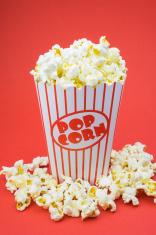 Classic box cinema popcorn on red background