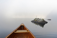 Cedar Canoe and Rocks on a Misty Ontario Lake