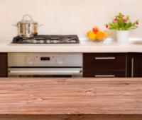 Lunch table on modern kitchen interior background